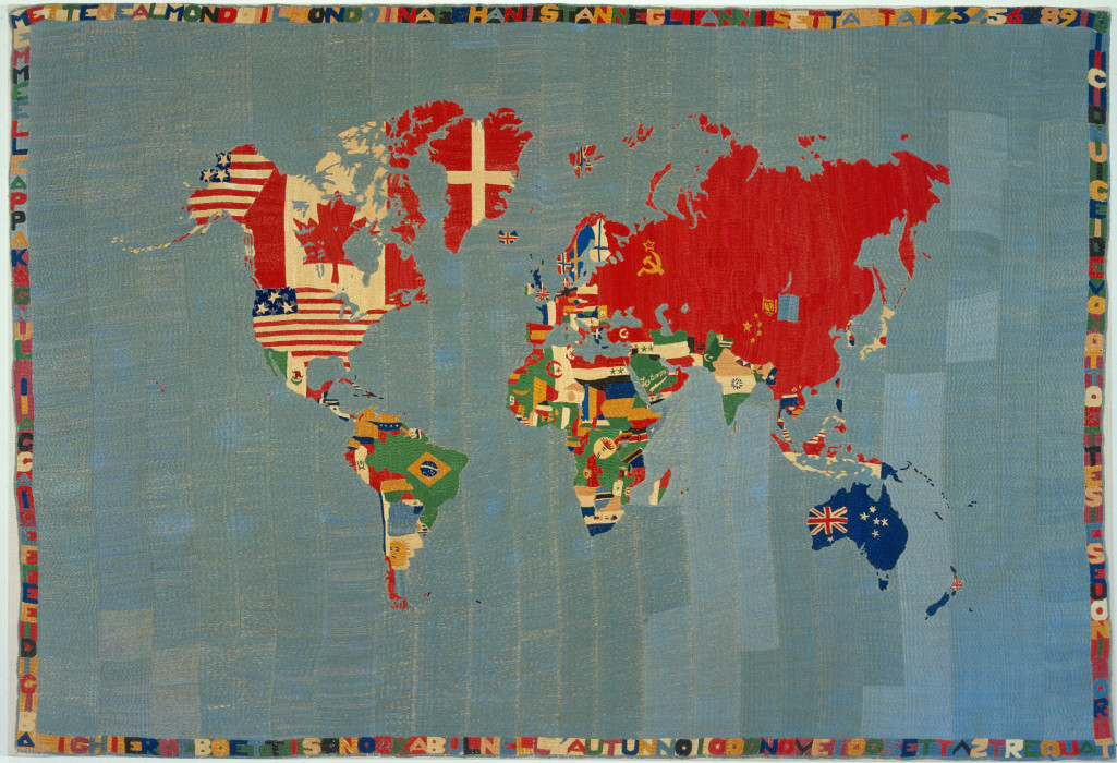 Rectangular map of the world with flags embroidered on their respective countries and a border of letters and numbers.