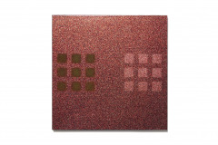 Square, sparkly red-orange painting overlaid with two 3 x 3 grids of dark green squares at center left and pink squares at center right.