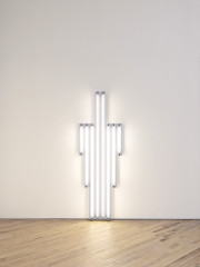 Eight fluorescent white tubes installed vertically against a wall with the two tallest in the middle and three increasingly smaller tubes flanking them on each side.
